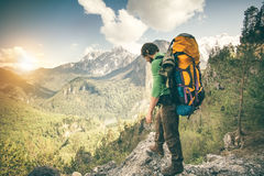 Young Man with backpack relaxing outdoor Travel Stock Photo