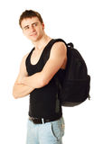 Young man with backpack. Smiling young college student with backpack, isolated against white Stock Photography