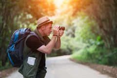 Young man backpacker travelling and photographer in local Royalty Free Stock Photography