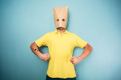 Young man with bag over head posing Stock Image