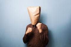 Young man with bag over his head in fighting stance Stock Images