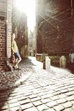 Young man with bag on street, old town Gdansk Stock Photo