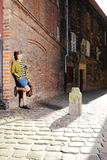 Young man with bag on street, old town Gdansk Stock Image