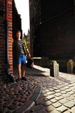 Young man with bag on street, old town Gdansk Stock Images