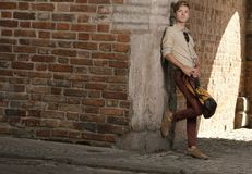 Young man with bag on street, old town Gdansk Stock Photos