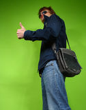 Young man with the bag, traveler Royalty Free Stock Image