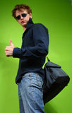 Young man with the bag, traveler Royalty Free Stock Photography