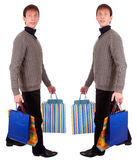 Young man and bags Royalty Free Stock Photo