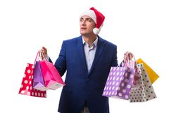 The young man with bags after christmas shopping on white background Royalty Free Stock Photo