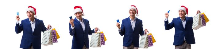 Young man with bags after christmas shopping on white background stock photos