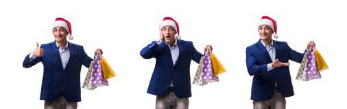 The young man with bags after christmas shopping on white background royalty free stock image