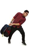 Young man with bags isolated on the white Stock Images