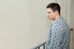 Young man at balcony in depression sufferin stock images