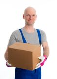 Young man with bald head and cardboard Stock Photography