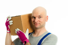 Young man with bald head and cardboard Royalty Free Stock Image