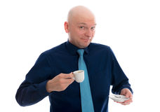 Young man with bald head drinking espresso. Young man with bald head in front of white background drinking espresso Stock Photos
