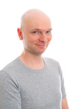 Young man with bald head  is smiling in to the camera Royalty Free Stock Image