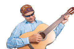 Young man in a bandana playing guitar isolated. White background Stock Images
