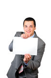 Young man and a banner. Portrait of a young man holding a blank banner isolated on white background Stock Images