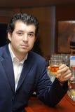 Young man in a bar Stock Photos