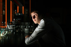 Young Man at the Bar Royalty Free Stock Image