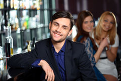 Young man in the bar Stock Images