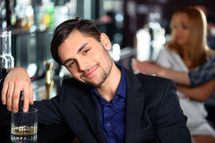 Young man in the bar Stock Image