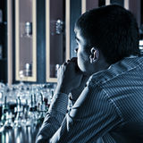 Young Man at the Bar Stock Photography