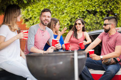 Young man at a barbecue with his friends Royalty Free Stock Images