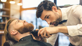 Young Man in Barbershop Hair Care Service Concept Royalty Free Stock Photos