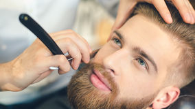 Young Man in Barbershop Hair Care Service Concept Royalty Free Stock Images