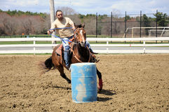Young man barrel racing Stock Photo