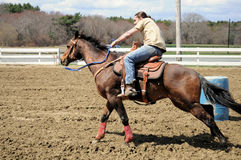 Young man barrel racing Stock Image