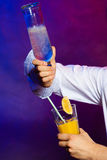Young man bartender pouring a drink Royalty Free Stock Images