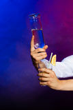 Young man bartender pouring a drink Royalty Free Stock Photos