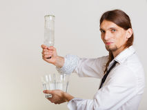 Young man bartender pouring a drink, studio shot Royalty Free Stock Photography