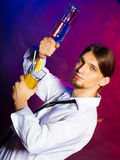 Young man bartender pouring a drink Royalty Free Stock Photo