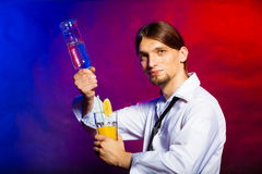 Young man bartender pouring a drink Stock Images