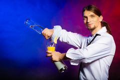 Young man bartender pouring a drink Royalty Free Stock Photography