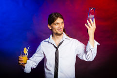 Young man bartender pouring a drink Stock Image