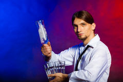 Young man bartender pouring a drink Stock Photos