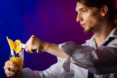 Young man bartender preparing alcohol cocktail drink Royalty Free Stock Image
