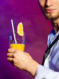 Young man bartender preparing alcohol cocktail drink Stock Photos