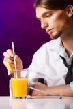 Young man bartender preparing alcohol cocktail drink Stock Photo