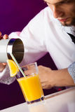 Young man bartender preparing alcohol cocktail drink Stock Image