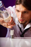 Young man bartender preparing alcohol drink Royalty Free Stock Photo