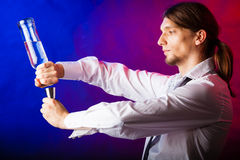 Young man bartender preparing alcohol drink Royalty Free Stock Photography