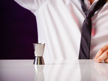 Young man bartender preparing alcohol drink Royalty Free Stock Photos