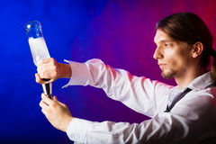 Young man bartender preparing alcohol drink Royalty Free Stock Image