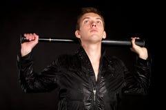Young man with baseball-bat stock image